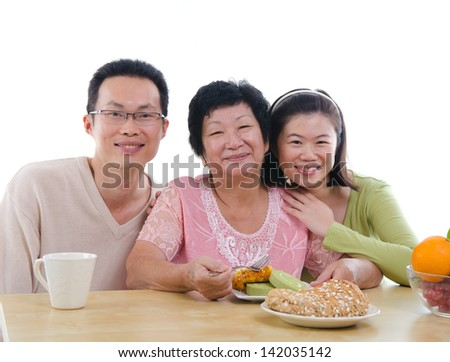 chinese family dining with isolated white background - stock photo
