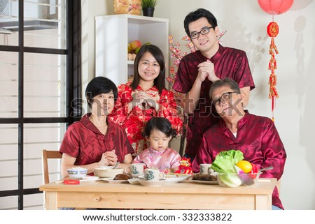 chinese family giving greetings during chinese new year - stock photo