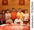 chinese family in dinner room - stock photo