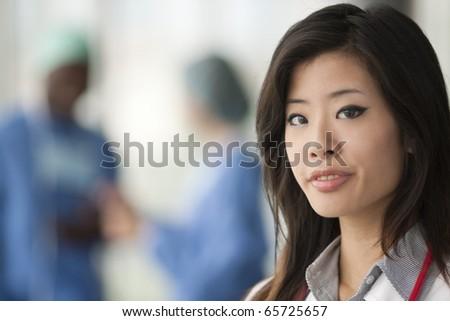 Chinese female doctor, surgeons on backgrounds - stock photo
