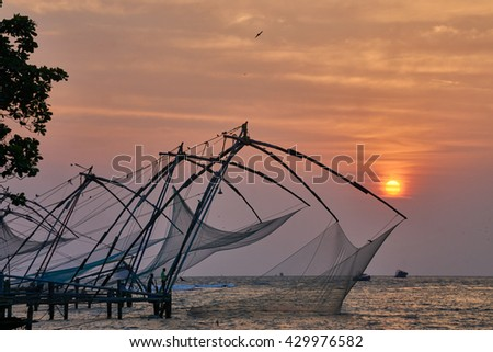 Chinese Fishing Net with sunset in the backdrop        - stock photo