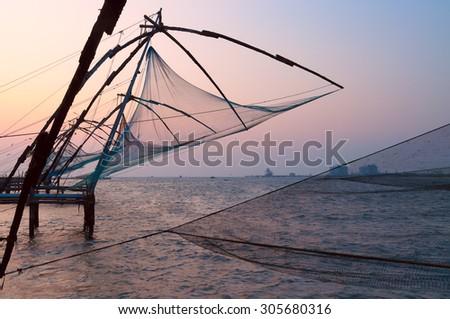 Chinese Fishing nets at sunset. Fort Kochi. Kerala. India - stock photo