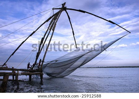 Chinese fishing nets in Fort kochin, Kerala, India. - stock photo