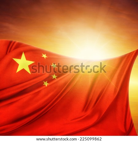 Chinese flag in front of bright sky - stock photo