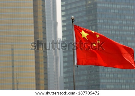 Chinese Flag on the Bund with Pudong Skyscrapers in the Background - stock photo