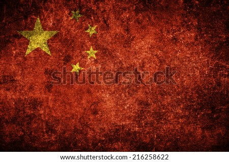 Chinese flag on the grunge concrete wall - stock photo