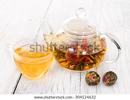 Chinese flowering tea on a wooden background - stock photo