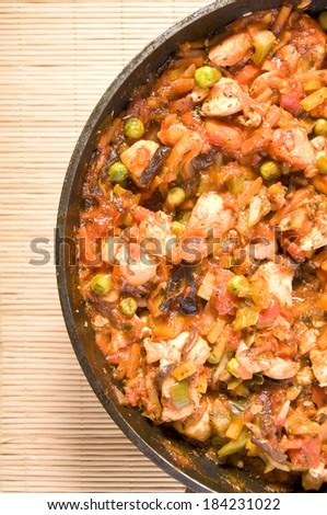 chinese food chicken with vegetables in tomato sauce