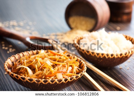 Chinese food. Egg noodles with chicken and vegetables, steamed rice and soy sauce. - stock photo