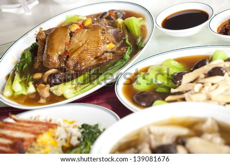 Chinese food, full rounded table of Chinese food, duck and sauce