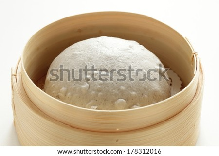 Chinese food, steamed Black sesame pasta bun in bamboo steamer