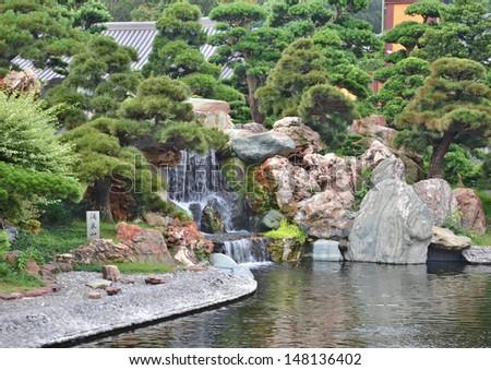 Chinese garden pond waterfall  - stock photo