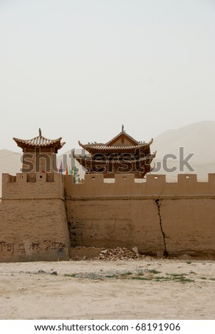 Chinese gate house along the great wall of China in the desert - stock photo