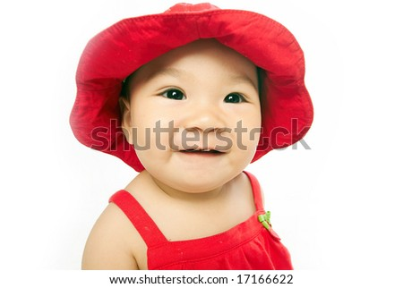 Chinese girl in red hat - stock photo