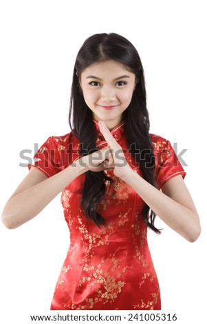 Chinese girl in traditional Chinese cheongsam greeting, isolated on white background  - stock photo