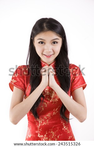 Chinese girl in traditional Chinese cheongsam on white background  - stock photo