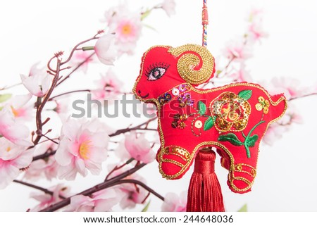 "chinese goat knot on white background, word for ""goat"", 2015 is year of the goat - stock photo"