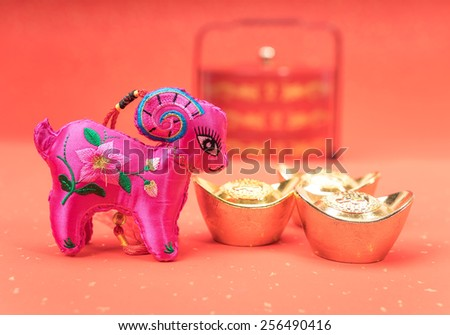 chinese goat toy on red background - stock photo