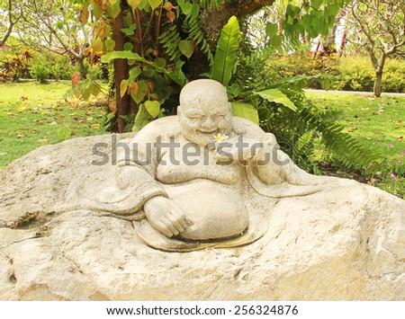 Chinese god statue stone - stock photo