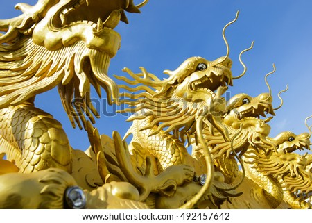 Chinese gold dragon symbol with blue sky