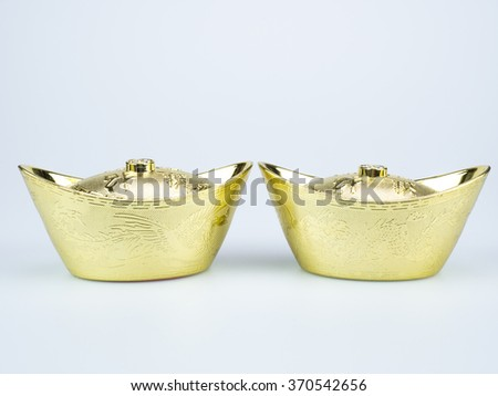 Chinese gold ingot with dragon and phoenix bird figure on white background for happy Chinese new year. - stock photo