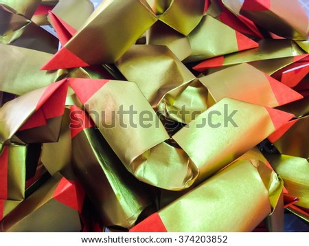 Chinese gold paper in Chinese traditional for burning  to the death people or spirits. - stock photo