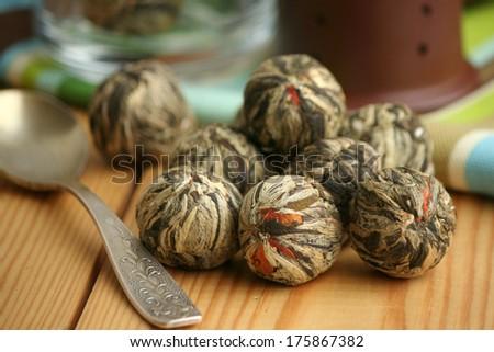 Chinese green tea balls with jasmine and marigold(calendula) flowers, ready to prepare - stock photo