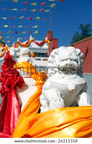 Chinese guardian lion in front of the temple - stock photo