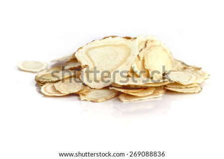 Chinese Herbal medicine - American Ginseng slices (Panax quinquefolius) on white background (manual focus) - stock photo