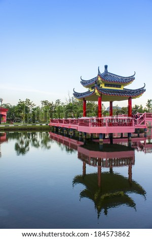 chinese historic building on the lake - stock photo