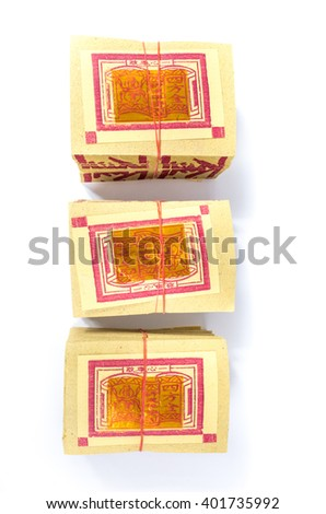 Chinese Joss Paper, traditional for passed away ancestor's   spirits with selective focus. (ghost money for Chinese dead people) Calligraphy means money. - stock photo
