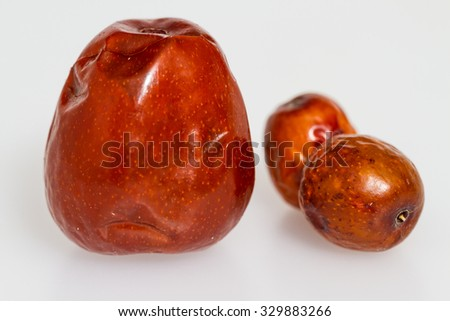 Chinese jujubes isolated on white background. Herbal food for heathy eating. - stock photo