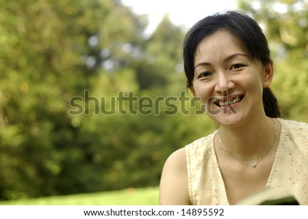 Chinese lady at garden - stock photo