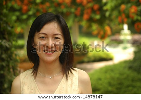 Chinese lady in garden - stock photo