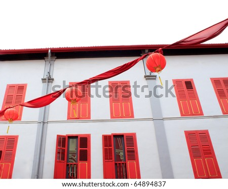 Chinese lamps with  colorful building background - stock photo