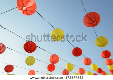 Chinese lantern across blue sky - stock photo