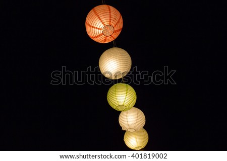 Chinese lantern festival, colorful traditional lampions in the darkness of night  - stock photo