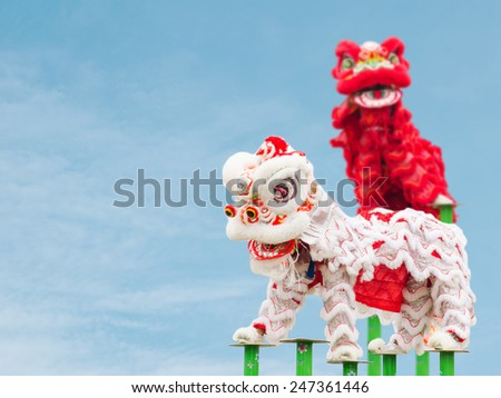Chinese lion costume dance during Chinese New Year celebration - stock photo