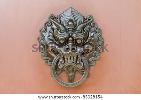 Chinese lion door knob - stock photo