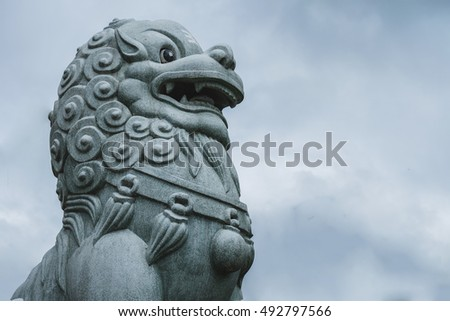 Chinese lion statue Located entrance Chinese Shrine.