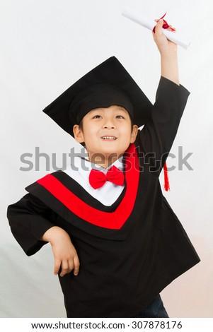Chinese little boy graduation in white backround studio shot. - stock photo