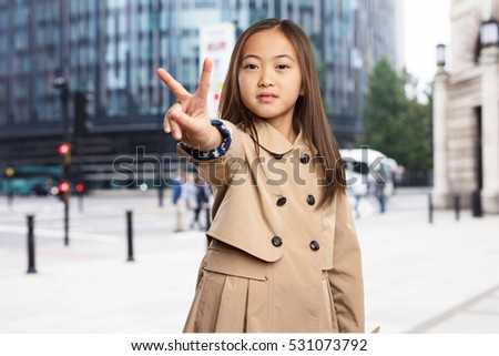 chinese little girl doing victory gesture