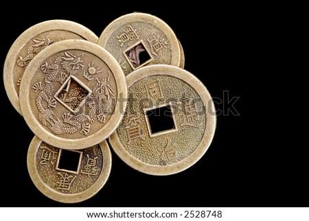 Chinese Lucky Coins on Black Velvet - stock photo
