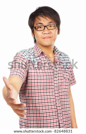 Chinese male young adult with welcoming gesture, isolated on white background - stock photo