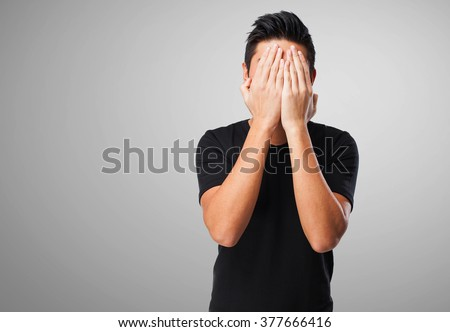 chinese man covering his face - stock photo