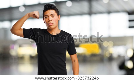 chinese man doing a strong gesture - stock photo