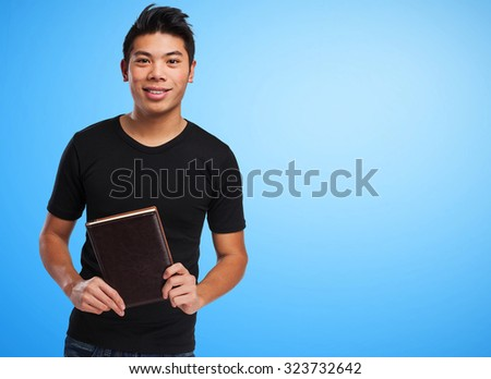 chinese man holding a book