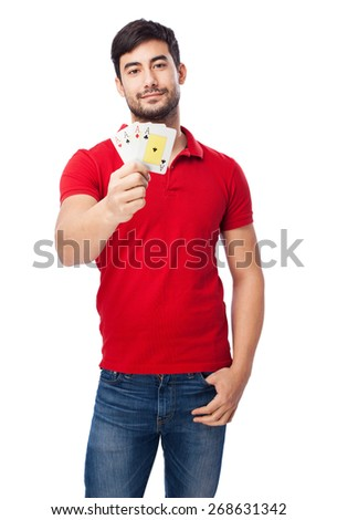 chinese man holding poker cards