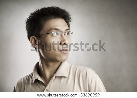 Chinese man looking away, series from several expression with vignetting and color hue in post processing - stock photo