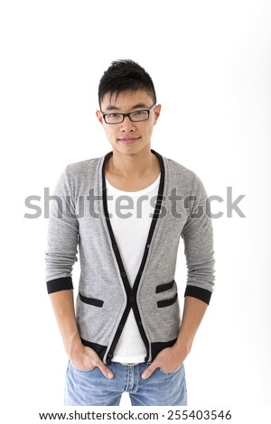 Chinese man wearing cardigan, t-shirt & Jeans. Isolated on White Background - stock photo